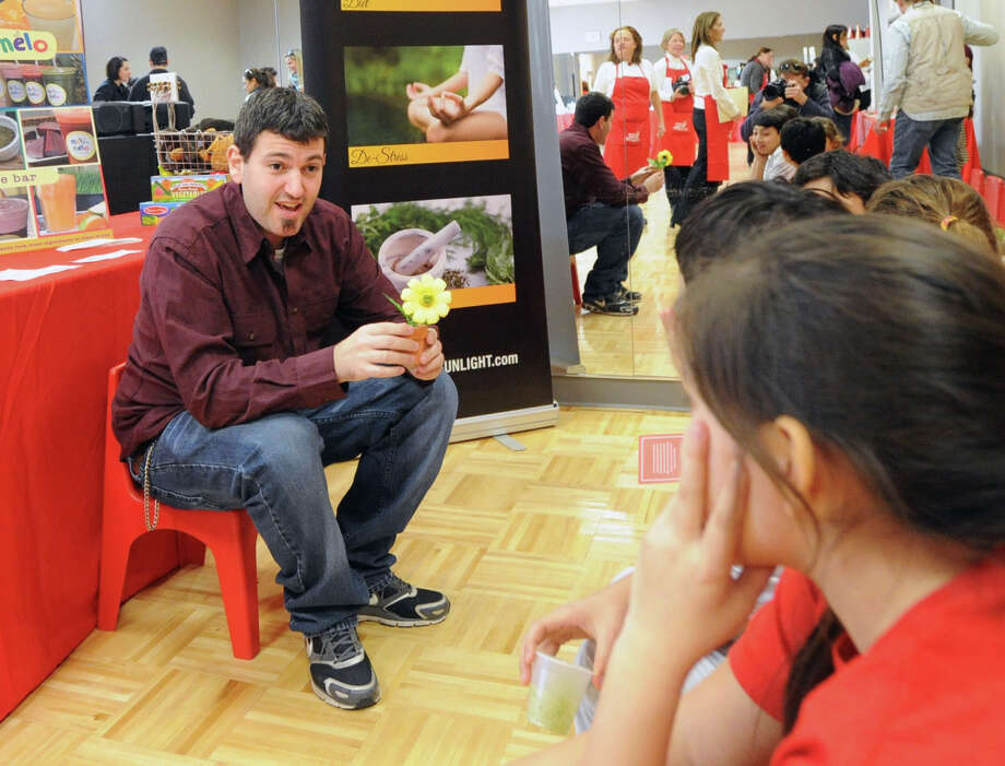 Holistic Health Coach, Kevin Reese, gives a talk about nutrition during the Kids in the Kitchen Fit & Fun Fest at the YWCA of Greenwich, Saturday afternoon, Feb. 1, 2014. The event was sponsored by the Junior League of Greenwich to promote children's health. Photo: Bob Luckey / Greenwich Time
