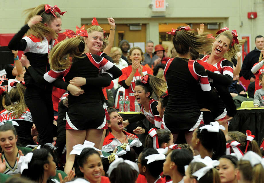Fairfield Warde celebrates as it takes top honors during the 17th Annual 2014 FCIAC Cheerleading Competition at Fairfield Warde High School in Fairfield, Conn. on Saturday February 1, 2014. Photo: Christian Abraham / Connecticut Post