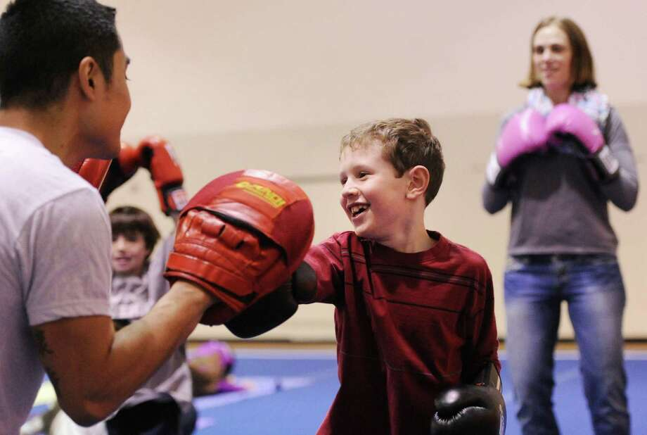 Tristan Baker, 6, of Stamford, learns kickboxing during the Kids in the Kitchen Fit & Fun Fest at the YWCA of Greenwich, Saturday afternoon, Feb. 1, 2014. Photo: Bob Luckey / Greenwich Time
