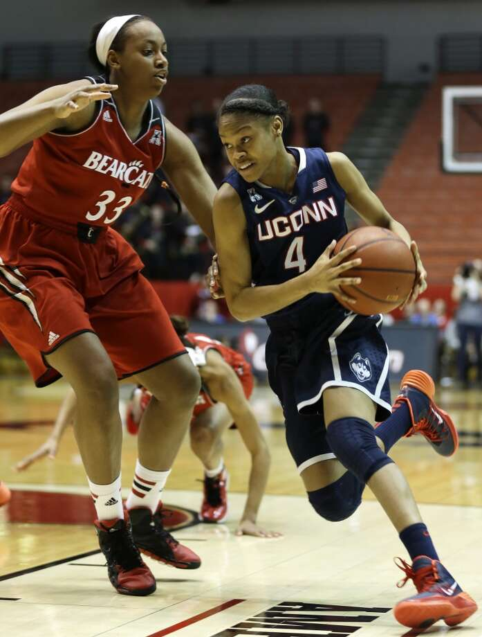 Connecticut guard Moriah Jefferson (4) drives against Cincinnati forward Jeanise Randolph (33) during the first half of an NCAA college basketball game, Saturday, Feb. 1, 2014, in Cincinnati. (AP Photo/Al Behrman) Photo: AP