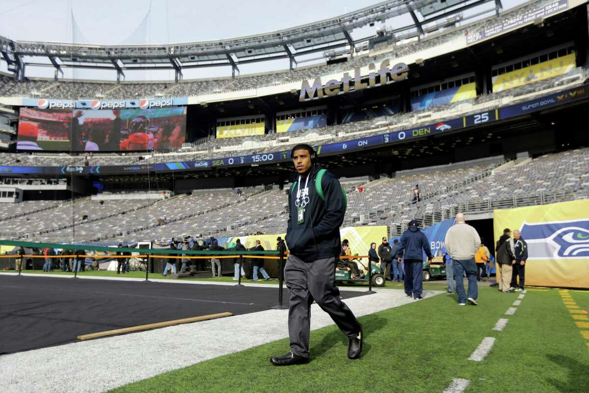 Seattle Seahawks linebacker Bobby Wagner walks onto the field inside MetLife Stadium during a brief visit by the team Saturday, Feb. 1, 2014, in East Rutherford, N.J. The Seahawks and the Denver Broncos are scheduled to play in the Super Bowl XLVIII football game Sunday, Feb. 2, 2014.