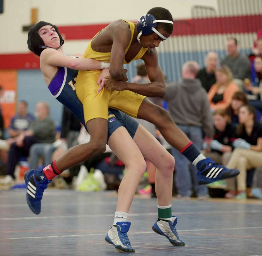 Lenyard's Emme Cronin, left, and Harding's Amir Phipps wrestle during New Fairfield High School's Duals Tournament, on Saturday, February 1, 2014, in New Fairfield, Conn. They are competing in the 106 lb. class. Photo: H John Voorhees III / The News-Times Freelance
