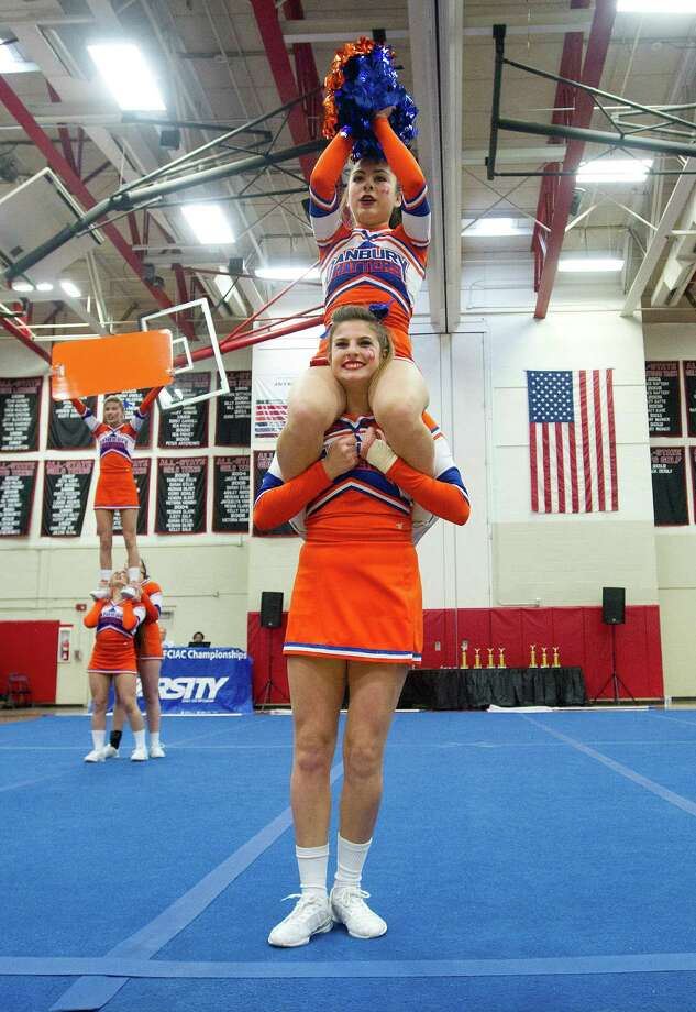 Courtney Sabene sits on the shoulders of Alden Grober as they compete with Danbury High School in the FCIAC cheerleading championships at Fairfield Warde High School in Fairfield, Conn., on Saturday, February 1, 2014. Photo: Lindsay Perry / Stamford Advocate