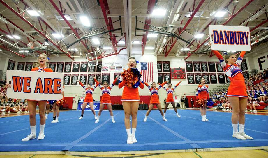 Danbury High School competes in the FCIAC cheerleading championships at Fairfield Warde High School in Fairfield, Conn., on Saturday, February 1, 2014. From left are Kennedy Shook, Alden Grober and Maddie Dunbar. Photo: Lindsay Perry / Stamford Advocate