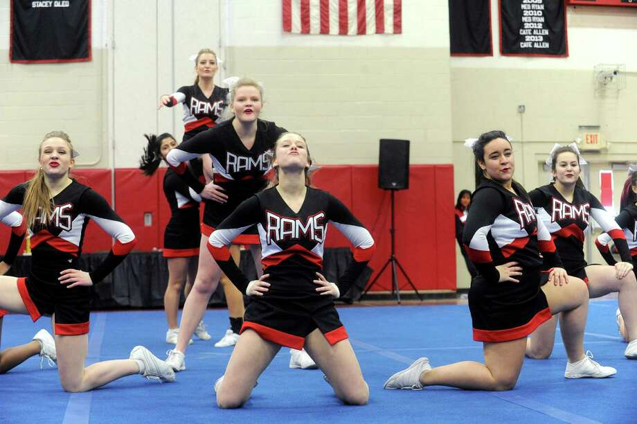 New Canaan High School competes in the FCIAC cheerleading championships at Fairfield Warde High School in Fairfield, Conn., on Saturday, February 1, 2014. Photo: Lindsay Perry / Stamford Advocate
