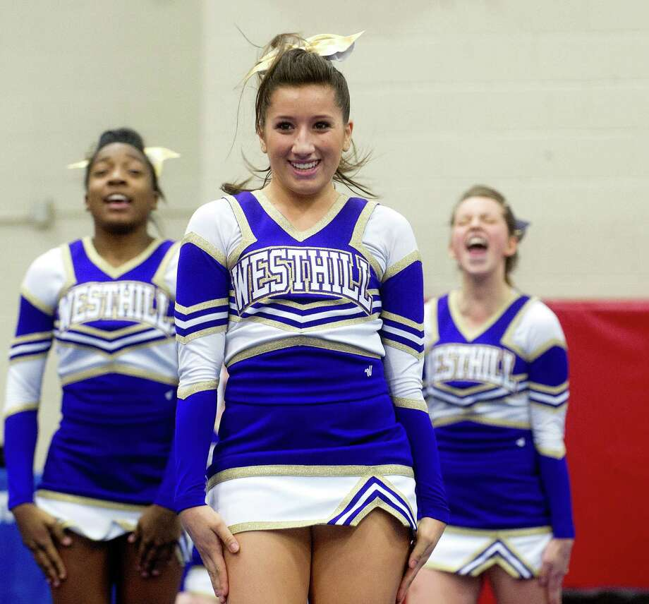 Zoe Carrillo of Westhill High School competes in the FCIAC cheerleading championships at Fairfield Warde High School in Fairfield, Conn., on Saturday, February 1, 2014. Photo: Lindsay Perry / Stamford Advocate