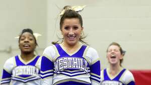 Zoe Carrillo of Westhill High School competes in the FCIAC cheerleading championships at Fairfield Warde High School in Fairfield, Conn., on Saturday, February 1, 2014.