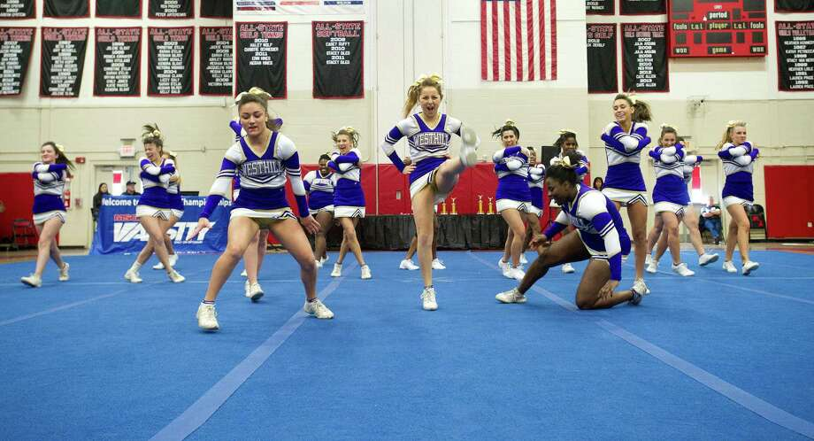 Westhill High School competes in the FCIAC cheerleading championships at Fairfield Warde High School in Fairfield, Conn., on Saturday, February 1, 2014. Photo: Lindsay Perry / Stamford Advocate