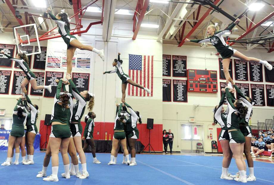 Norwalk High School competes in the FCIAC cheerleading championships at Fairfield Warde High School in Fairfield, Conn., on Saturday, February 1, 2014. Photo: Lindsay Perry / Stamford Advocate