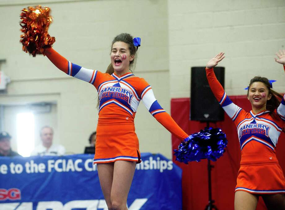 Nicole Fretias of Danbury High School competes in the FCIAC cheerleading championships at Fairfield Warde High School in Fairfield, Conn., on Saturday, February 1, 2014. Photo: Lindsay Perry / Stamford Advocate