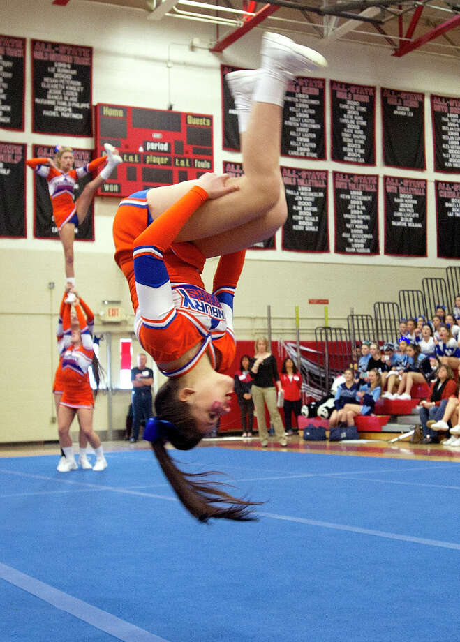 Kaylah Genao of Danbury High School competes in the FCIAC cheerleading championships at Fairfield Warde High School in Fairfield, Conn., on Saturday, February 1, 2014. Photo: Lindsay Perry / Stamford Advocate