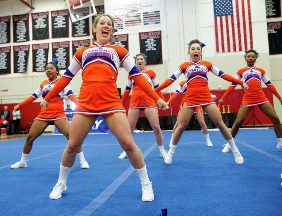 Amanda Calabrese, front, competes with Danbury High School in the FCIAC cheerleading championships at Fairfield Warde High School in Fairfield, Conn., on Saturday, February 1, 2014. Photo: Lindsay Perry / Stamford Advocate