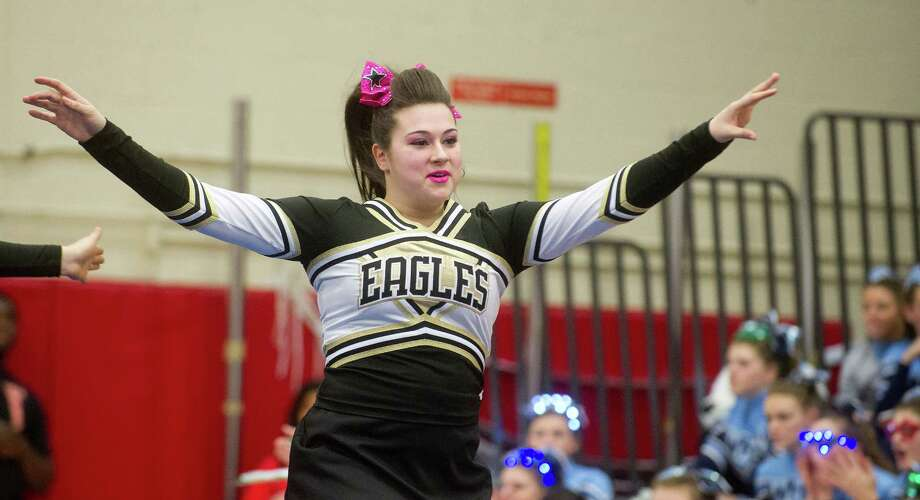 Kayla Gilronan of Trumbull High School competes in the FCIAC cheerleading championships at Fairfield Warde High School in Fairfield, Conn., on Saturday, February 1, 2014. Photo: Lindsay Perry / Stamford Advocate