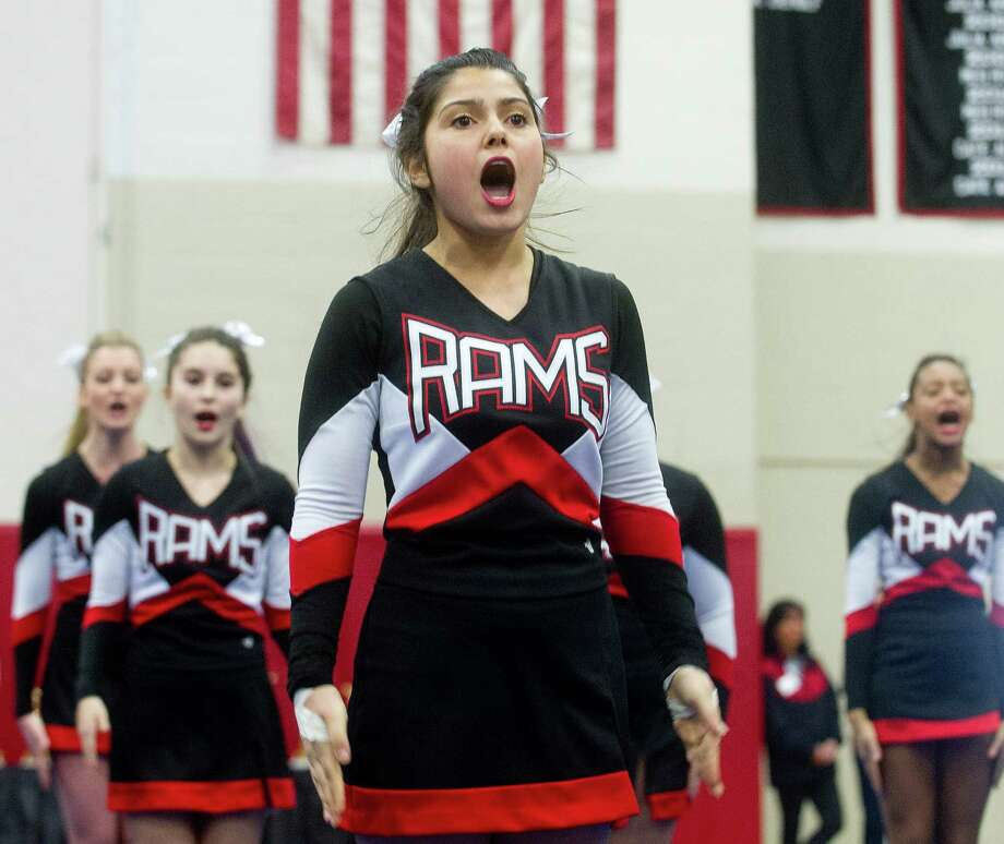 Arishen Adaljia of New Canaan High School competes in the FCIAC cheerleading championships at Fairfield Warde High School in Fairfield, Conn., on Saturday, February 1, 2014. Photo: Lindsay Perry / Stamford Advocate
