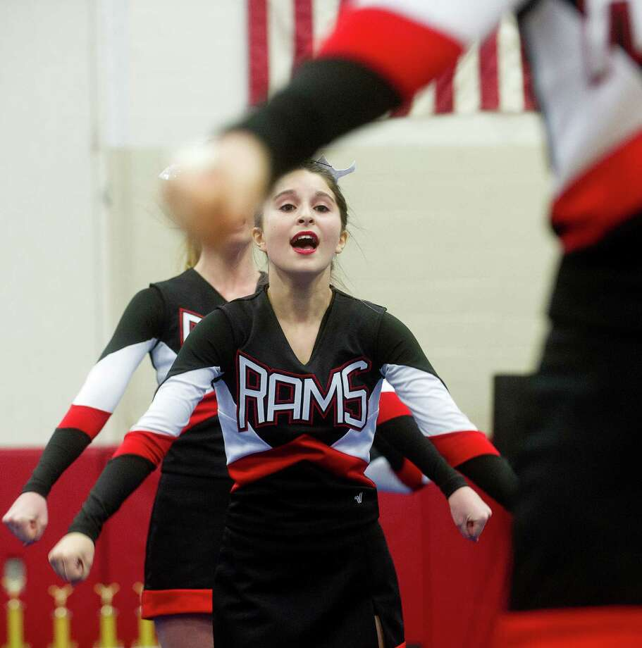 Lauren Meyers of New Canaan High School competes in the FCIAC cheerleading championships at Fairfield Warde High School in Fairfield, Conn., on Saturday, February 1, 2014. Photo: Lindsay Perry / Stamford Advocate