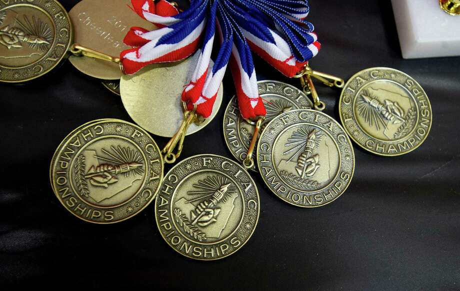 Medals wait to be awarded as high schools compete in the FCIAC cheerleading championships at Fairfield Warde High School in Fairfield, Conn., on Saturday, February 1, 2014. Photo: Lindsay Perry / Stamford Advocate