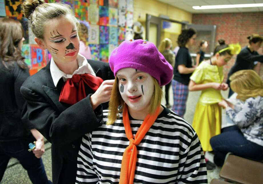 "Emma Farman gets some help with her Mime costume from Caroline Seely, left, who plays the Cat in the Hat, before the start of ""Seussical Jr."" at Bethlehem Central Middle School Saturday Feb. 1, 2014, in Delmar, NY.   (John Carl D'Annibale / Times Union) Photo: John Carl D'Annibale / 00025594A"