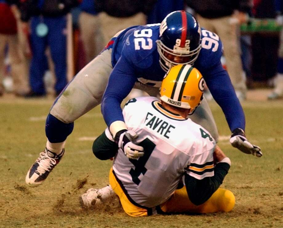 Michael Strahan sack of Brett Favre in 2001 broke the single-season record. He still owns the mark with 22.5 sacks. Photo: Bill Kostroun, Associated Press