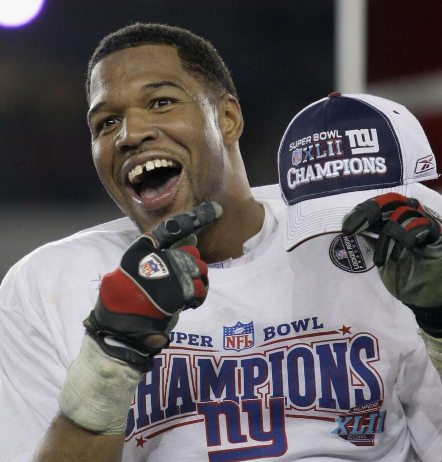 Michael Strahan celebrating after the Giants won the Super Bowl in 2008. Photo: David J. Phillip, Associated Press