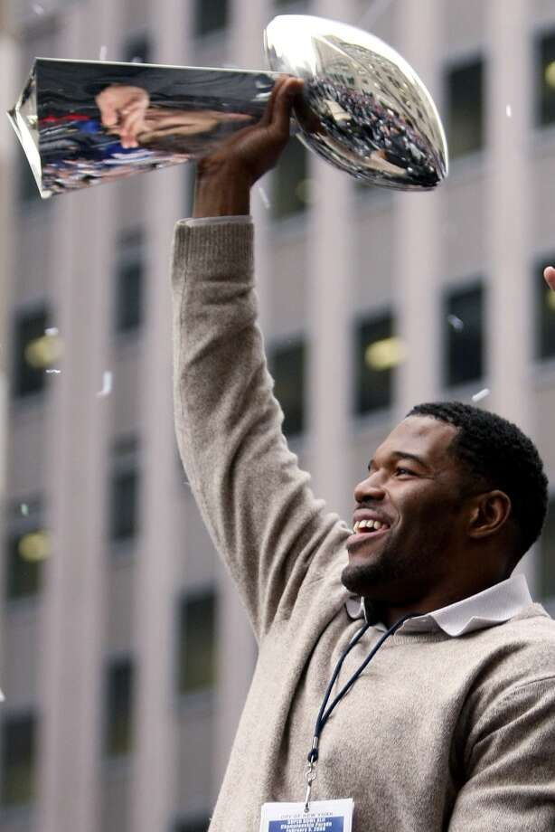 Michael Strahan hoisting the Super Bowl trophy when the Giants won the championship in 2008. Photo: Chris McGrath, Getty Images