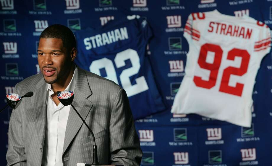 Michael Strahan announcing his retirement with the New York Giants. Photo: Andy Marlin, Getty Images