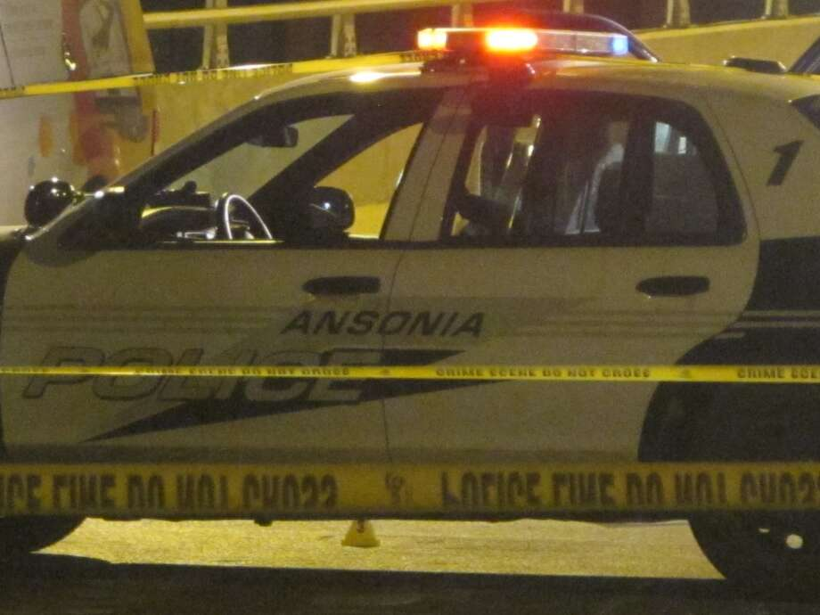 The area around the Maple Street bridge was blocked Saturday night as state investigators probed a shooting involving Ansonia police. Photo: Wes Duplantier/Connecticut Post