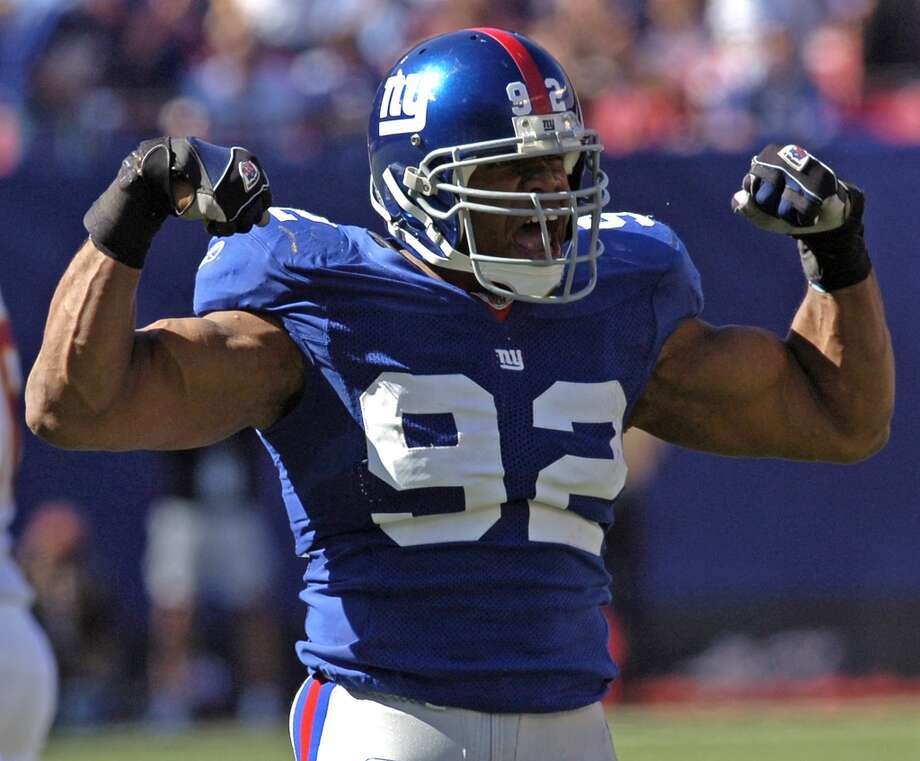 Michael Strahan, DE, New York Giants Photo: BILL KOSTROUN, Associated Press