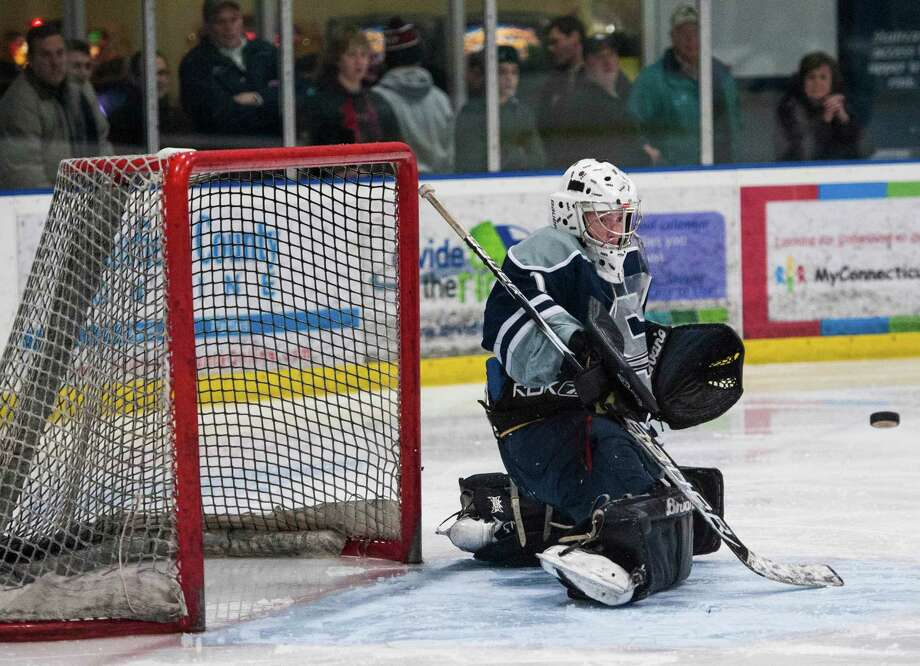 Staples high school goalie William Englehart gets in front of an incoming shot during a boys ice hockey game against St Joseph high school played at the Sports Center of Connecticut, Shelton, CT on Saturday, February, 1st, 2014. Photo: Mark Conrad / Connecticut Post Freelance