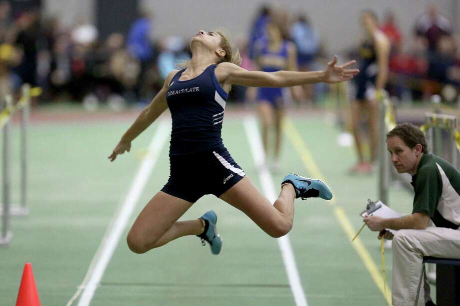 Immaculate High School's Despina Drougas goes into form during the long jump event at Saturday evening  SWC Track Championships held at the Floyd Litttle Athletic Center in New Haven. Photo: Mike Ross / Mike Ross Connecticut Post freelance -www.mikerossphoto.com