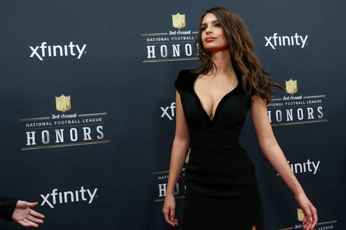 Model and actress Emily Ratajkowski walks the red carpet before the NFL Honors awards ceremony on Saturday, February 1, 2014 at Radio City Music Hall in New York City.
