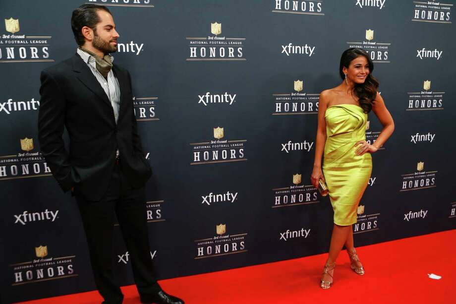 Actress Emmanuelle Chriqui and actor Adrian Bellani walk the red carpet before the NFL Honors awards ceremony on Saturday, February 1, 2014 at Radio City Music Hall in New York City. Photo: JOSHUA TRUJILLO, SEATTLEPI.COM / SEATTLEPI.COM