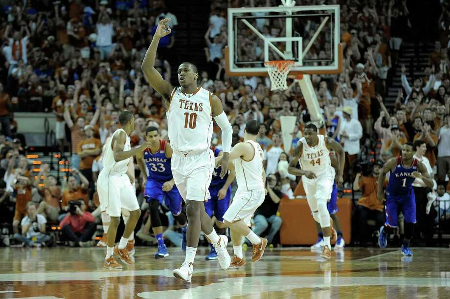 AUSTIN, TX - FEBRUARY 01:  Jonathan Holmes #10 of the Texas Longhorns reacts to a three point shot against the Kansas Jayhawks during a game at The Frank Erwin Center on February 1, 2014 in Austin, Texas.  Texas won the game 81-69. Photo: Stacy Revere, Getty Images / 2014 Getty Images
