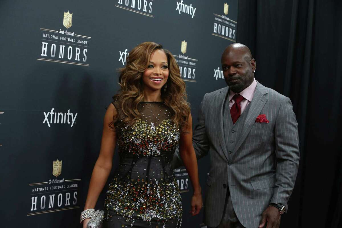 Emmett Smith and his wife, Patricia, walk the red carpet before the NFL Honors awards ceremony on Saturday, February 1, 2014 at Radio City Music Hall in New York City.