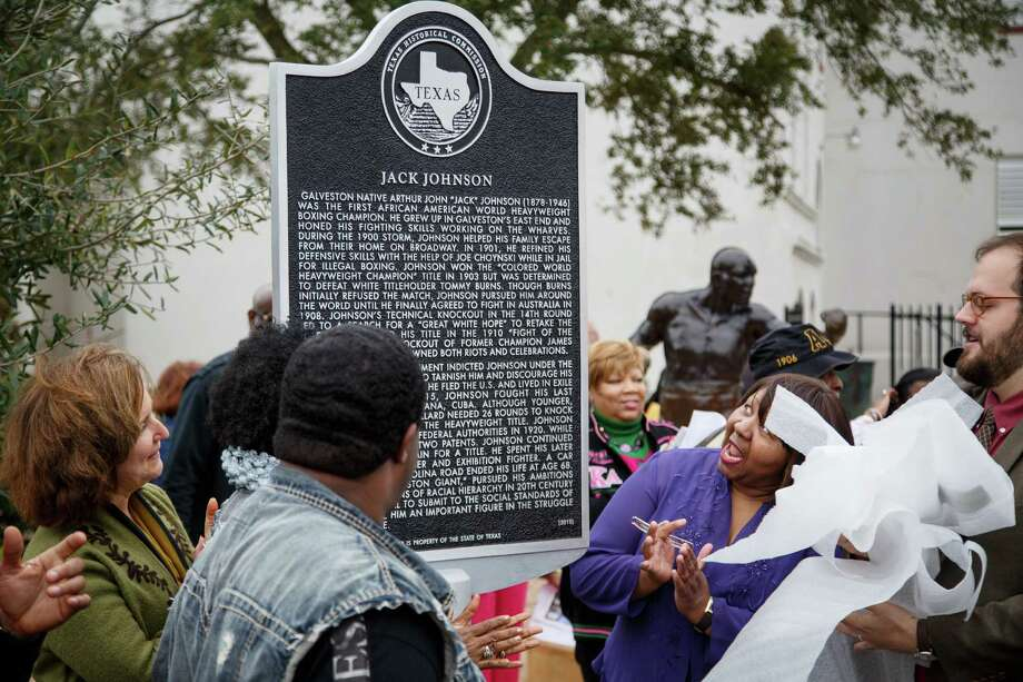"Linda Haywood, second from right, the great-great niece of Jack Johnson, reacts after seeing the historical marker honoring Jack Johnson, the first black world heavyweight champion, at Jack Johnson Park, Saturday, Feb. 1, 2014, in Galveston.  The monument is the first state recognition of the boxer, whose victory over a white opponent gave rise to the search by racists for ""the Great White Hope"" to defeat the black champion. Photo: Michael Paulsen, Houston Chronicle / © 2014 Houston Chronicle"