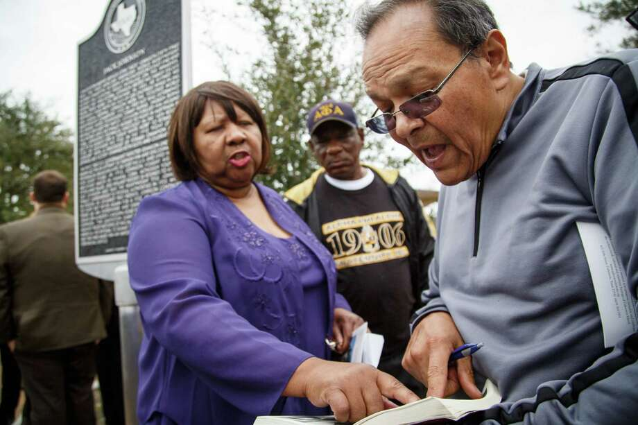 Linda Haywood, left, the great-great niece of Jack Johnson, points to a family photo in a book held by Andy Lopez during the dedication ceremony of a historical marker honoring Jack Johnson. Photo: Michael Paulsen, Houston Chronicle / © 2014 Houston Chronicle