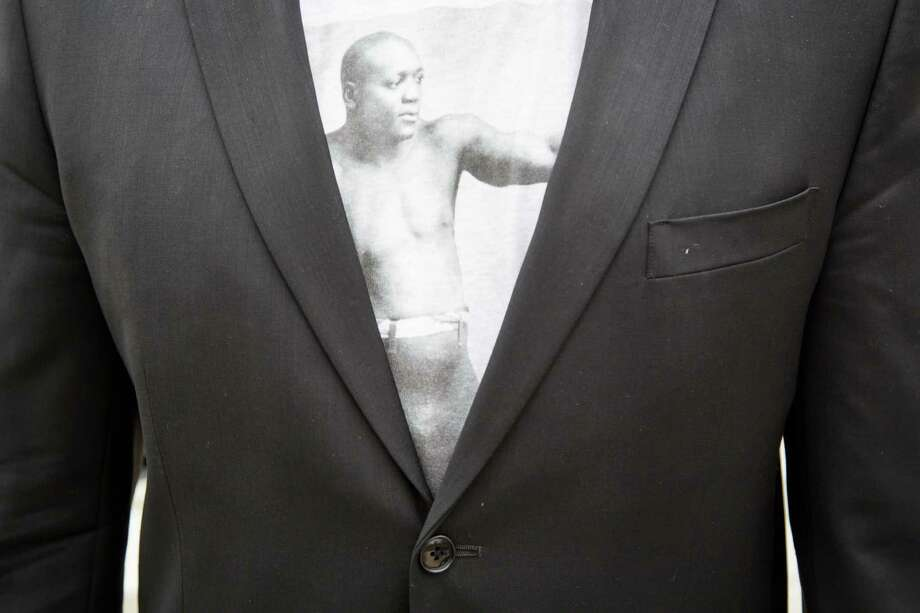 A man wears a shirt with Jack Johnson on it under his suit coat during the dedication ceremony of a historical marker honoring Jack Johnson. Photo: Michael Paulsen, Houston Chronicle / © 2014 Houston Chronicle