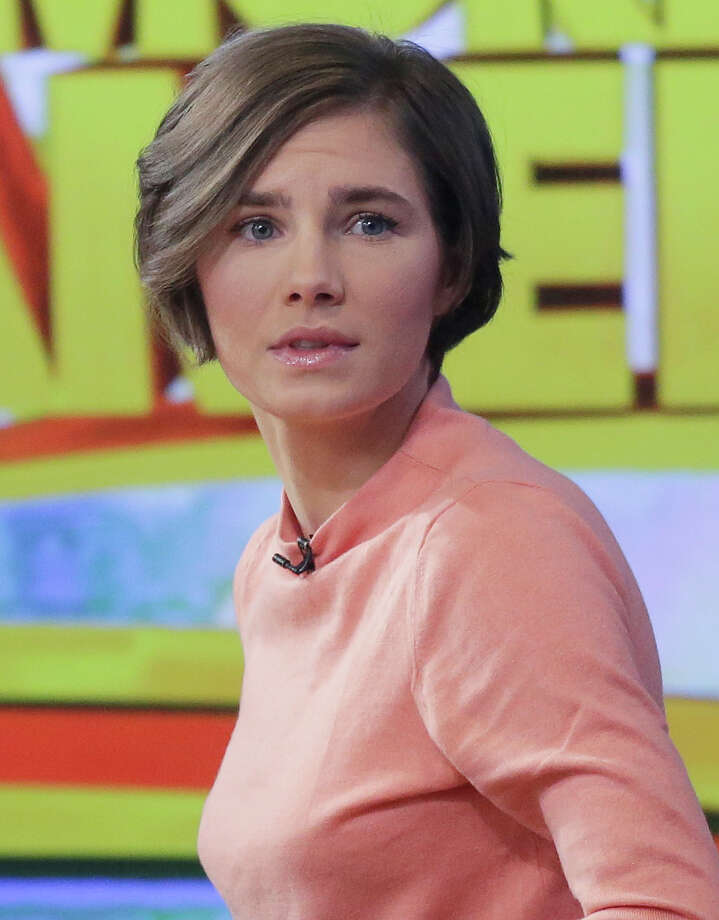 Amanda Knox prepares to leave the set following a television interview, Friday, Jan. 31, 2014 in New York. To many Americans, especially in her hometown of Seattle, Amanda Knox seems the victim, unfairly hounded by a capricious foreign legal system for the death of a 21-year-old British woman. But in Italy and elsewhere in Europe, others see her as someone who got away with murder, embroiled in a case that continues to make global headlines and reinforces a negative image of Americans behaving badly _ even criminally _ abroad without any punishment. As she remains free in the U.S., these perceptions will not only fuel the debate about who killed Meredith Kercher in 2007 and what role, if any, Knox played in her death, but also about whether U.S. authorities should, if asked, send her to Italy to face prison. (AP Photo/Mark Lennihan) Photo: Mark Lennihan, STF / AP