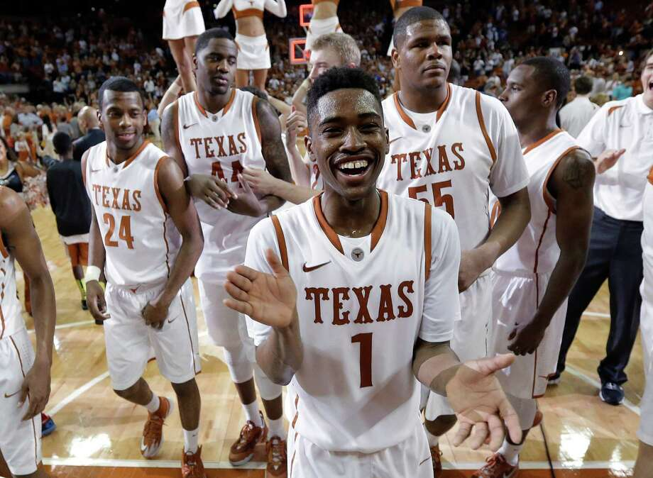 Freshman guard Isaiah Taylor (1) made half of his field-goal attempts and all of his free throws to lead Texas with 23 points in defeating Kansas. Photo: Eric Gay, STF / AP