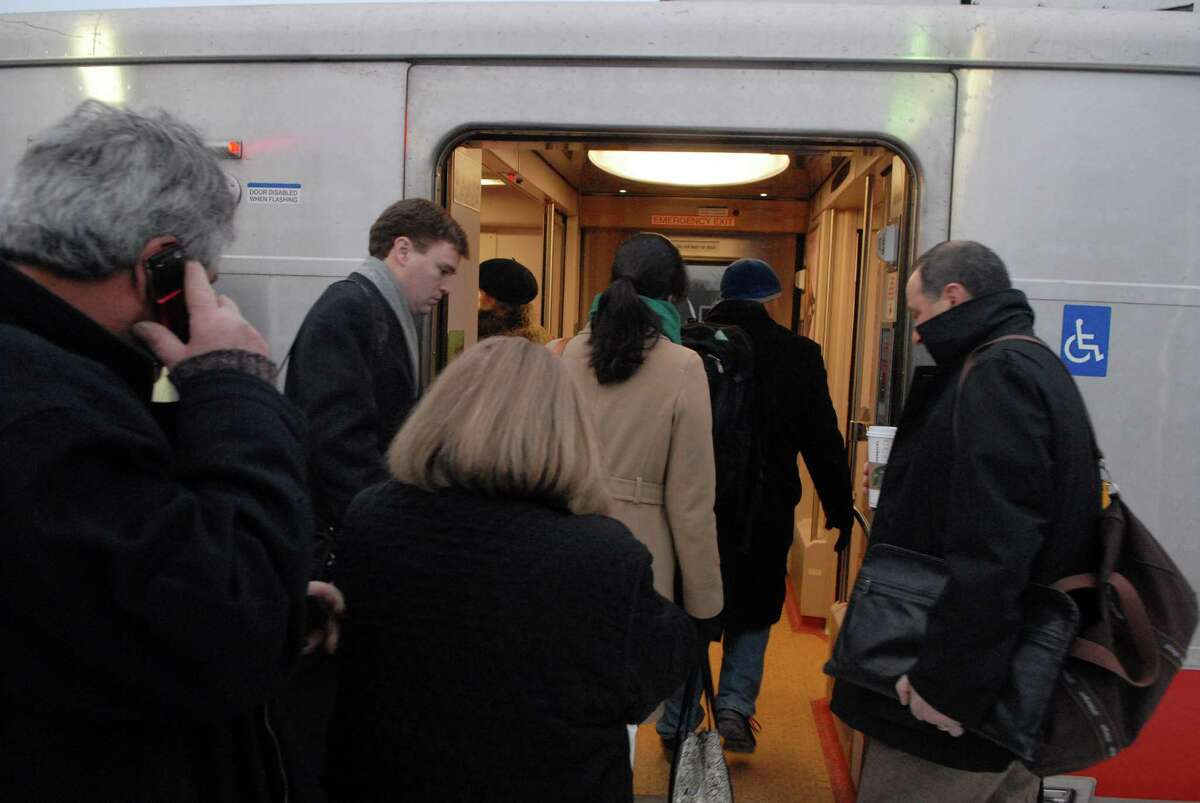 Commuters board the 7:25 a.m. Metro-North train from Darien to Grand Central Terminal.
