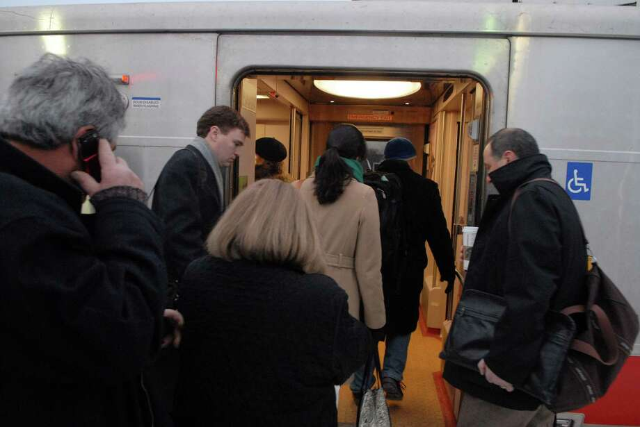 Commuters board the 7:25 a.m. Metro-North train from Darien to Grand Central Terminal. Photo: Dru Nadler / Stamford Advocate Freelance