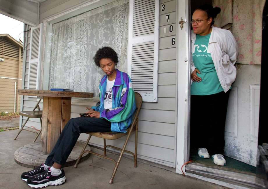 Patricia Fuller stands on her front porch with her daughter, Tatiana Cortez, 17, on Friday, Jan. 31, 2014, in Houston. Fuller recently found out that she qualified for Medicaid. ( Brett Coomer / Houston Chronicle ) Photo: Brett Coomer, Staff / © 2014 Houston Chronicle