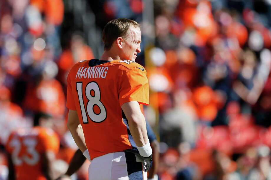 Broncos quarterback Peyton Manning learned how to deal with celebrity by watching his dad, former Saints QB Archie Manning. Photo: Kevin C. Cox, Staff / 2014 Getty Images