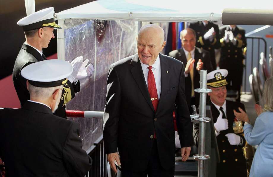 John Glenn is applauded by high ranking Naval Officers shortly after his daughter Lyn Glenn smashed the ceremonial bottle of champagne on the side of the USNS John Glenn during its christening  at General Dynamics NASSCO, Saturday Feb. 1, 2014, in San Diego, Calif.  (AP Photo/UT San Diego, Charlie Neuman) MANDATORY CREDIT Photo: Charlie Neuman, MBR / UT San Diego