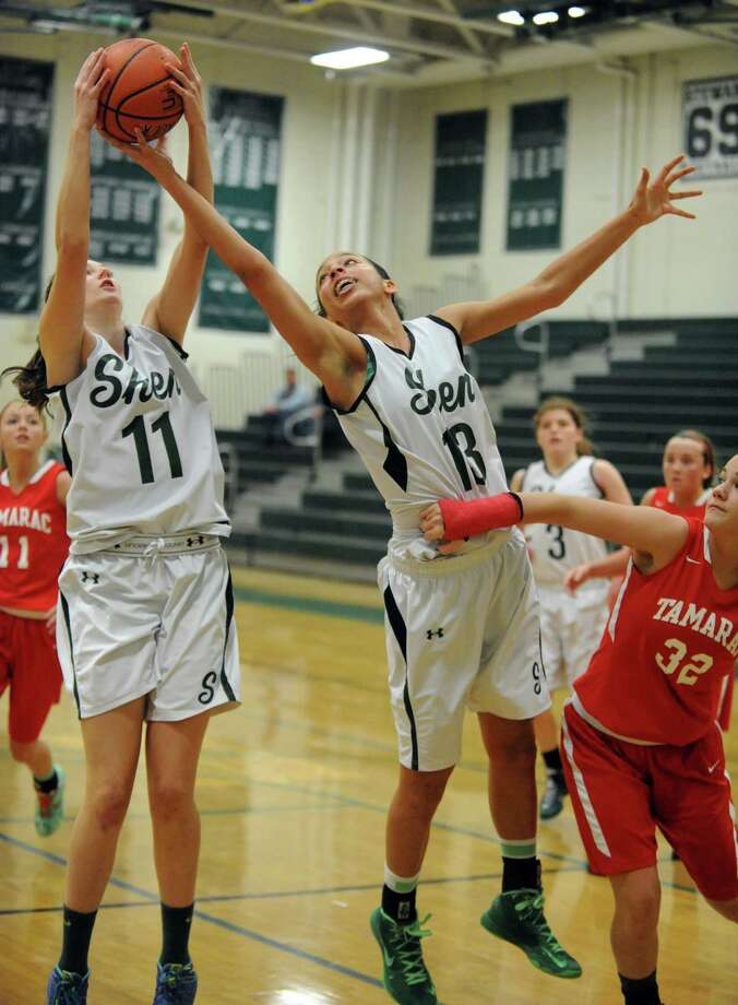 Shen's Morgan O'Brien, left, and Sydney Brown go up for a rebound during their girl's high school basketball game against Tamarac on Saturday Feb. 1, 2014 in Clifton Park, N.Y. (Michael P. Farrell/Times Union) Photo: Michael P. Farrell / 10025584A
