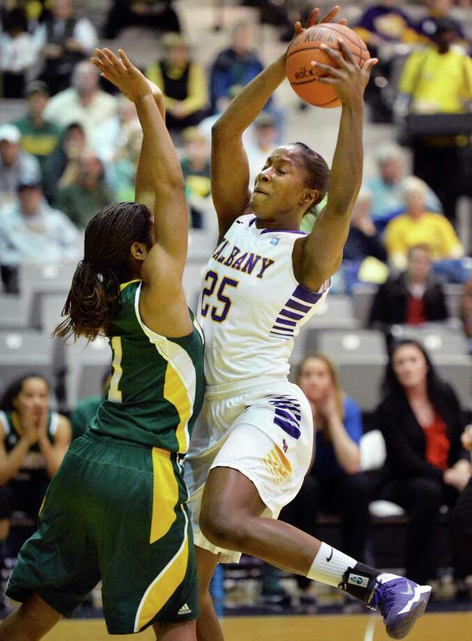 UAlbany's #25 Shereesha Richards, at right, and Vermont's #1 Kylie Butler tangle under the basket during the Big Purple Growl game Saturday Feb. 1, 2014, in Albany, NY.   (John Carl D'Annibale / Times Union) Photo: John Carl D'Annibale / 00025543A