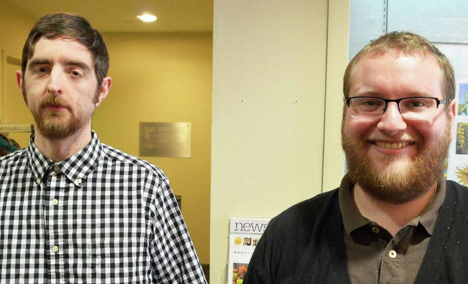 Andy Kravis of Brooklyn, N.Y., right, won the crosswords competition Saturday at the Westport Library, and Glen Ryan of Norwich, last year's champion, finished third. Kravis had won the tourney in 2012 as well. Photo: Jarret Liotta / Westport News contributed