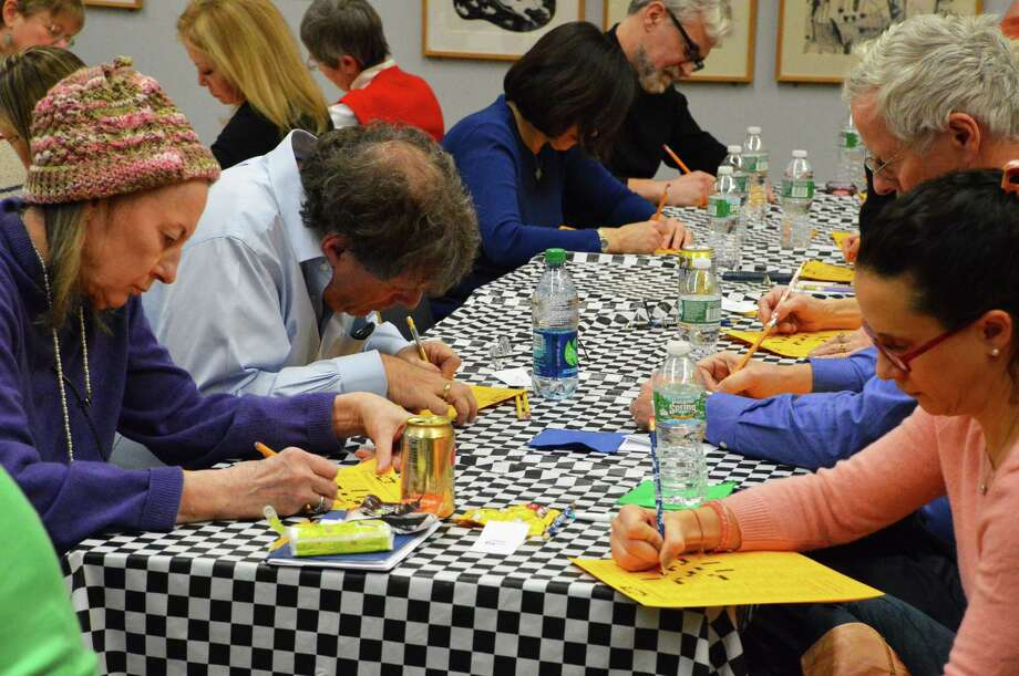 Puzzlers are the picture of concentration Saturday at the Westport Library's 15th annual Crossword Puzzle Contest. Photo: Jarret Liotta / Westport News contributed