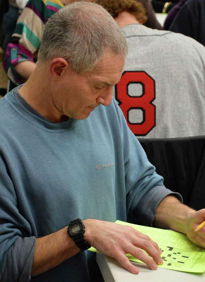 Efrem Kramberg of Westport at work on a puzzle at the 15th annual Crossword Puzzle Contest at the Westport Library. Photo: Jarret Liotta / Westport News contributed