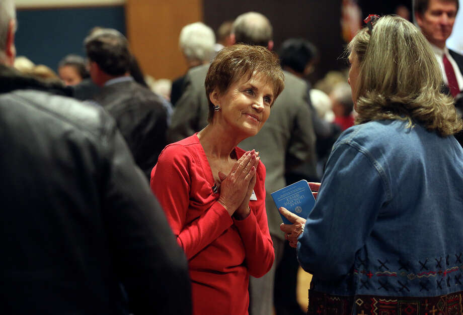 Sharon Hall, volunteer for Houston Sen. Dan Patrick, talks with attendees of a Republican candidates forum in New Braunfels last week. Photo: TOM REEL