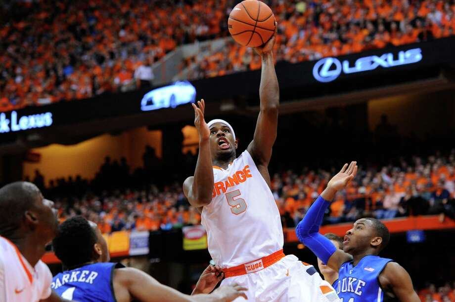 SYRACUSE, NY - FEBRUARY 01:  C.J. Fair #5 of the Syracuse Orange takes a shot over Jabari Parker #1 (L) of the Duke Blue Devils during the first half at the Carrier Dome on February 1, 2014 in Syracuse, New York.  (Photo by Rich Barnes/Getty Images) ORG XMIT: 185398997 Photo: Rich Barnes / 2014 Getty Images